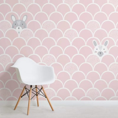 image of kids pink popup rabbits wallpaper wall mural with chair and flooring