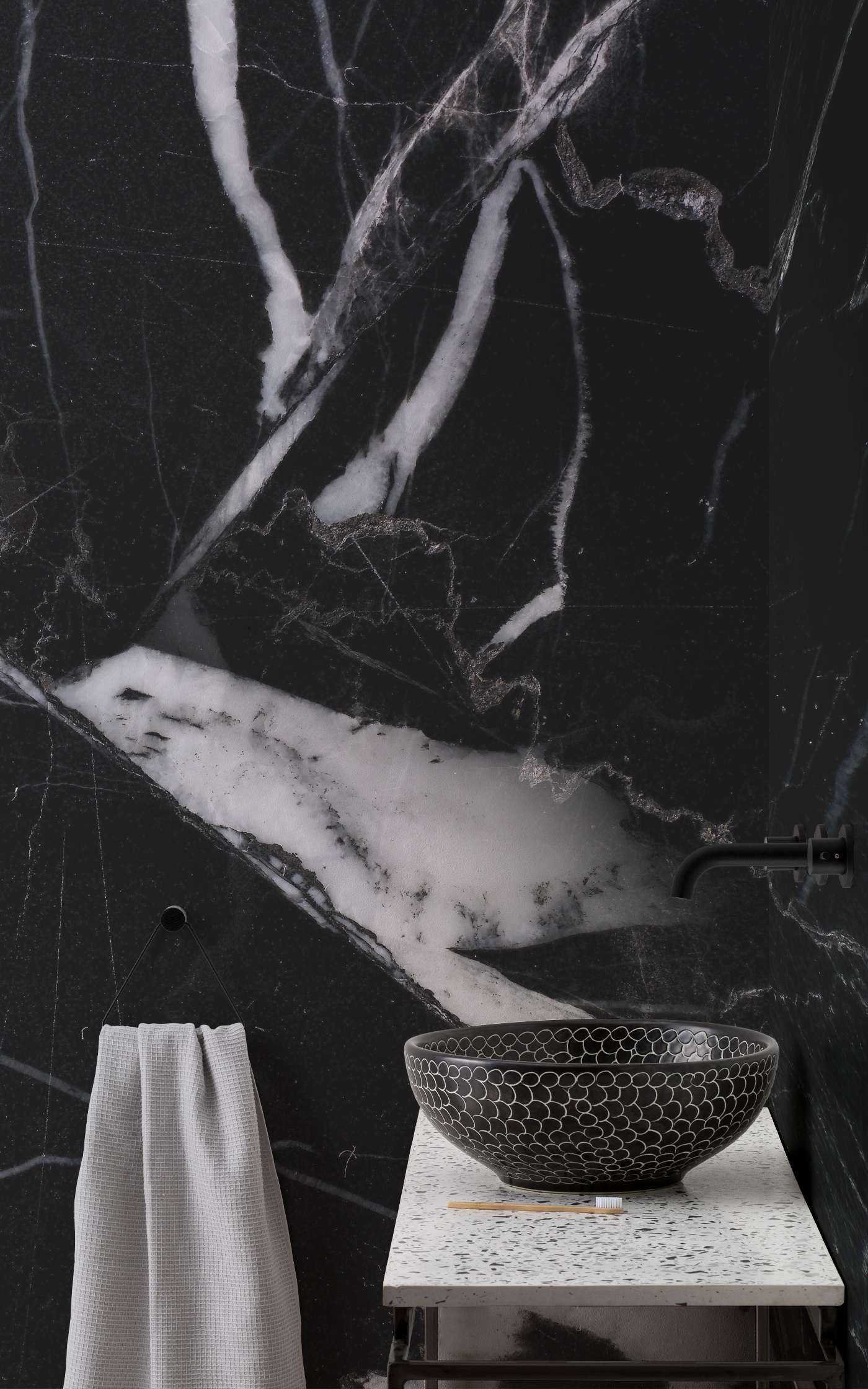 Zain black marble mural in bathroom